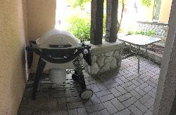 Front patio with weber gas barbecue and outdoor table & chairs
