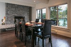 Dining area with fireplace and view of the lake.