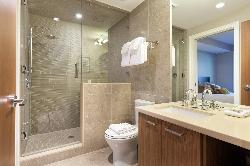 Main floor bathroom including a Steam shower located off # 2 bedroom and access from the media room