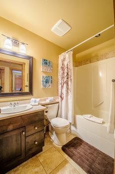 2nd bathroom with shower and bathtub combination.