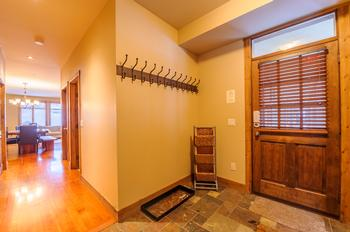 Front entrance with plenty of closet space and a bench seat.