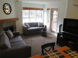 Large comfortable living space with two sofa beds and new entertainment centre.