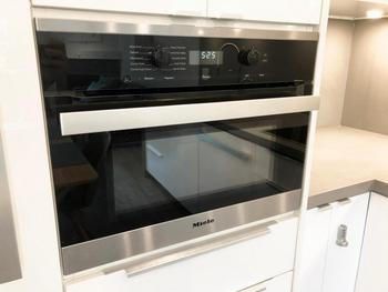 Miele's uniquely designed combination convection/microwave oven! Also included is a Miele induction cook-top/hob and a silent dishwasher!