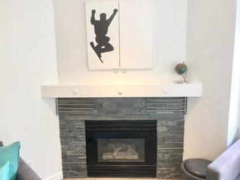 Updated fireplace stone with built-in storage above and drying racks.