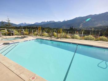 Pool, hot tub and 2 BBQ's with fabulous mountain views