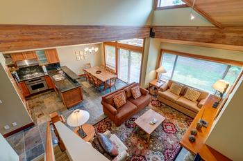 Open floor plan with vaulted ceilings and steps to the hot tub on the patio.
