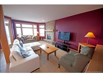 The large open living room can comfortably seat your family, while you enjoy the fireworks or relax after skiing