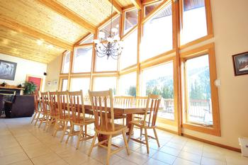 Grand dining room with cathedral ceilings. The table can seat up to 16!