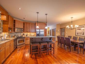 Unit 22 - gourmet kitchen, island seating, dining area - bright and spacious