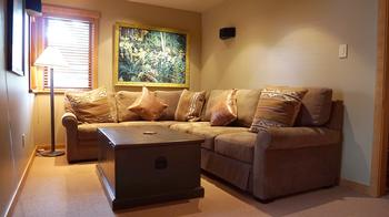 Family room with pullout queen sofabed and surround sound TV system