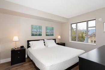 Spacious master bedroom with king size bed.