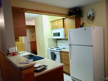 Fully Equipped Kitchen with Stove/Oven Microwave, Dishwasher and Coffee Maker