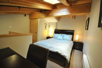 Loft with Queen Bed Skylight and Desk