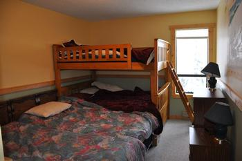 2nd bedroom with 1 single & double size bunks. Only 1 single, not 2 as shown