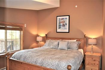 Master bedroom with King bed, TV and ensuite