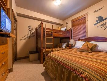 2nd bedroom with a double bed and single over single bunks.