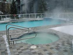 large heated pool and two hot tubs