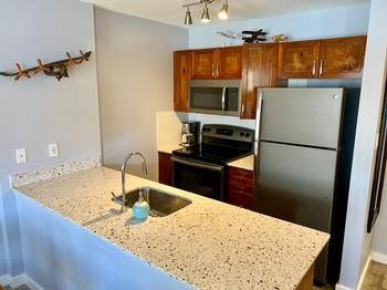 Fully appointed kitchen with full size appliances includes dishwasher, coffee maker, toaster and electric kettle. Hide photo list