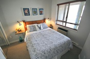 Bedroom overlooks the balcony with views of Blackcomb mountain and ski slopes.