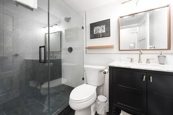 Main bath - with modern glass enclosed shower, all new fixtures