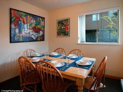 The Dining Area sits six people, with three more at the Kitchen Counter