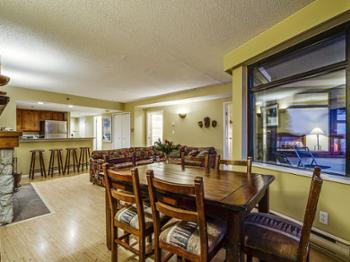 Spacious living/dining area includes a balcony with stunning views