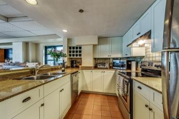 Fully equipped kitchen with new appliances and cabinets.