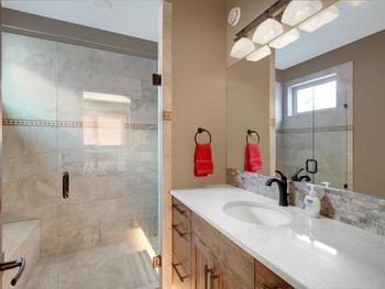 3rd master ensuite with large shower with built in bench seat, automatic under cabinet lighting and heated floors.