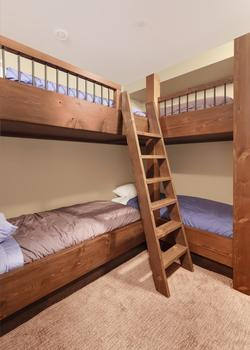 The Bunk Room. Sleeps 6 in single beds. Has a full wardrobe with plenty of space for everyone's clothing. A ensuite washroom is attached to this room.