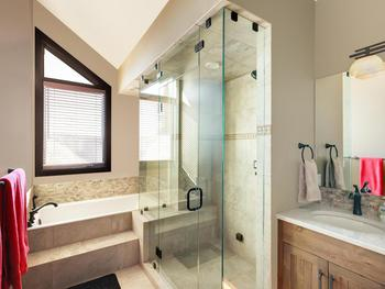Master ensuite bathroom with large open and bright shower with a  separate bathtub. Seating bench in the shower perfect for relaxing with  the steam on . Heated floors , large vanity and plenty of space.