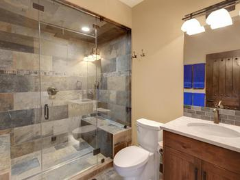 Lower floor full bathroom with steam shower . Rinse off after a hot tub  or sauna.