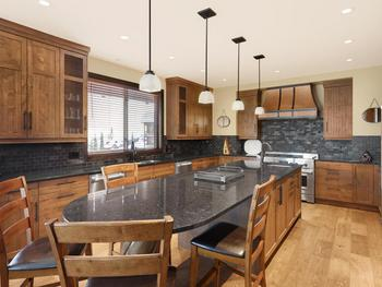 The large kitchen island has seating at one end for 5, a separate sink  and faucet at the other end right where you need it while cooking.