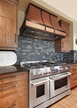 Professional series gas cooktop with 6 burners, side griddle and two  separate ovens. Don't forget about the large BBQ on the deck just off  the kitchen and an second fridge by the garage entrance just steps away.