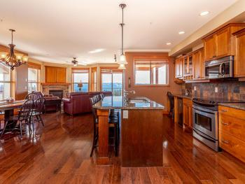 Large open floor plan with plenty of natural light and great views. See the fireworks from your deck.