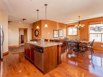 Tastefully finished, warm and inviting kitchen and dining rooms.
