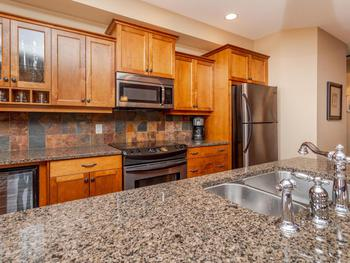 Large open gourmet kitchen with granite countertops, kitchen island and all the equipment a Chef needs to prepare amazing meals.