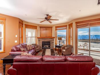 Very comfortable plush leather sofas with a cozy gas fireplace and great views of the winter wonderland of Big White.