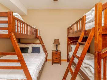 Bunk Room with three single and one double bed.