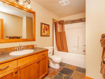 Main bathroom with shower and bathtub combination and heated floors.