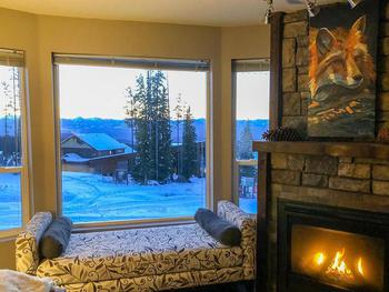 Cozy fireplace with a view of Monashee Mountains