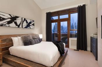 Master Bedroom: Queen Bed with TV, private balcony and ensuite bathroom