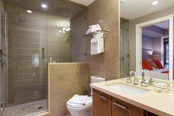 Lower level shared bathroom with steam shower and ensuite to bedroom 4