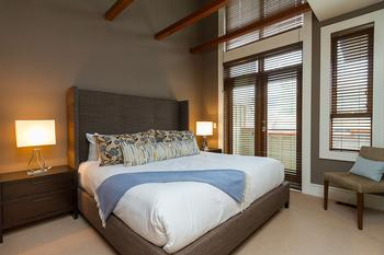 Master Bedroom: King bed with private balcony, TV, gas fireplace and ensuite bathroom