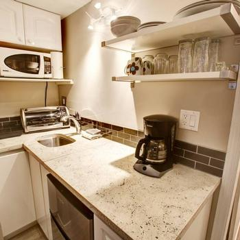 Excellent location and value! Described and photographed just as you see in the advertisement. Small but very usable kitchen....we made an awesome dinner and had all the tools we needed to do so.--Alishia