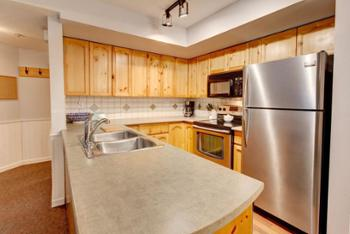 Large Fridge, Lots of appliances including: Toaster, microwave, oven, stove, kettle, coffee maker more.