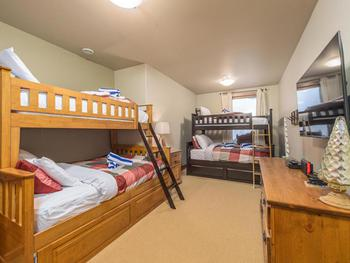Lower Bunk Room - an additional single over double bunk has been added. We are also adding a 50 inch TV with a video game system .