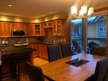Full view of the kitchen, which includes a great APRES seating area where you can relive your mountain adventures with the cook! The kitchen includes basic staples like soap products, saran wrap, etc, storage containers and all cooking supplies you would need. We also keep basic food staples in the cupboards to share with guests. Tip! Organize your groceries in advance & get them delivered at arrival (Nesters Whistler), so that you can get down to relaxing and having fun ASAP!