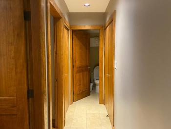 Here is a view from the lower level looking down the hall. The bathroom is at the end and the laundry facilities are right next to it. The bedrooms lead off to the left.