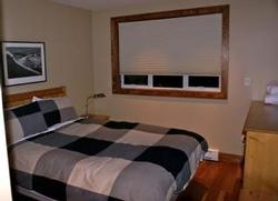 This is the first bedroom you come to as you stroll down the hallway towards the bathroom. This is a queen bed. The bedrooms have lots of closet space, which is getting hard to find in Whistler! We provide comfy, cozy & fluffy bathrobes for each adult guest!