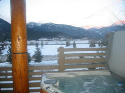 Relax in your private hot tub overlooking Green Lake and the mountains to the North.